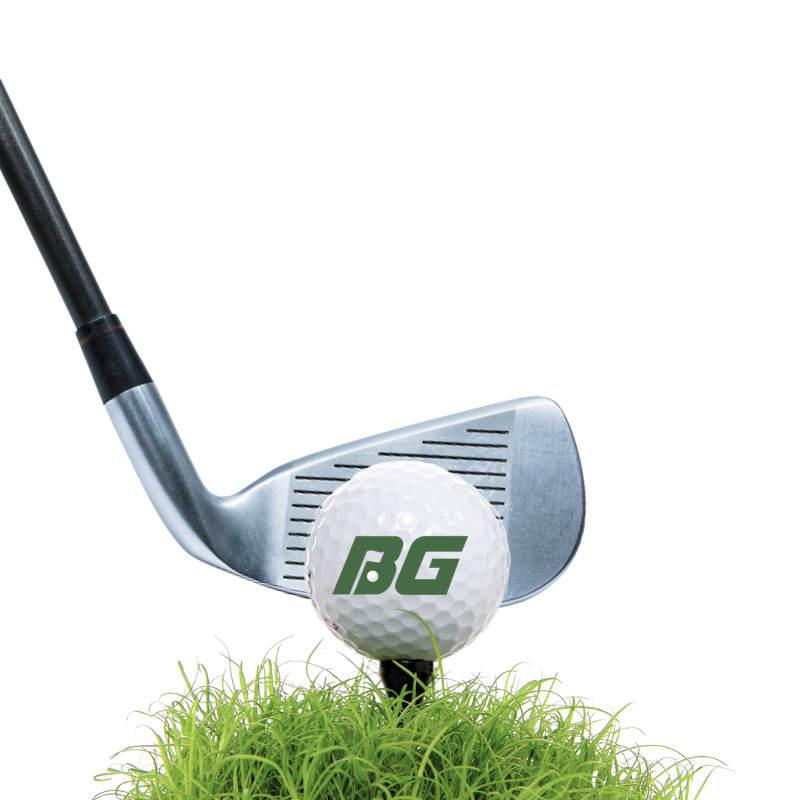 Golf Club hitting golf ball on grass